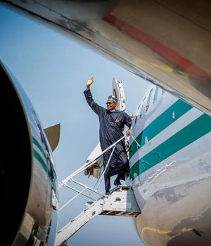 President Buhari waves as he boards presidential jet to Poland