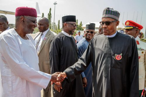 President Buhari shakes hands with Chief of Staff, Abba Kyari