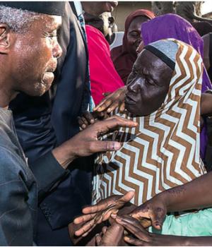 Vice President Yemi Osinbajo (left) interacting with members of Karu community in Abuja