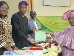 Tunji Bello presenting the Certificate of Service and Plaque to retired Permanent Secretary, Ministry of Information and Strategy, Mrs Kofo Awobamise, while the Head of Service, Mrs Sade Adesoye (1st Left)