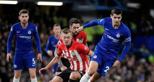 Alvaro Morata dribbles past Southampton players