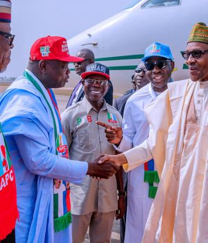Buhari in a handshake with Gov. Ambode