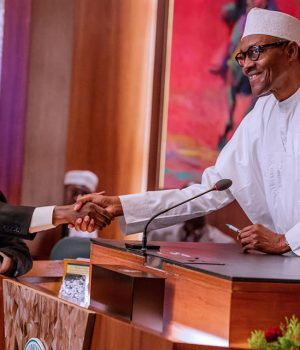 President Buhari congratulates Justice Ibrahim Tanko Mohammed after swear-in as Acting CJN