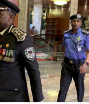 Idris leading new IGP Mohammed Adamu to President Buhari's office