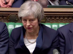 Theresa May sits down in Parliament after the vote on May's Brexit deal