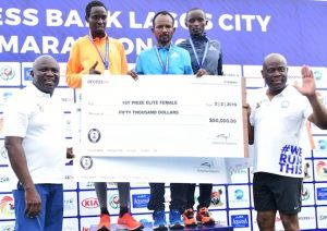 Gov. Ambode, Herbert Wigwe, MD Access Bank with top three winners of the Access Bank Lagos City Marathon