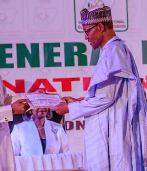 President Buhari receives Certificate of Return from INEC Chairman, Prof. Mahmood Yakubu