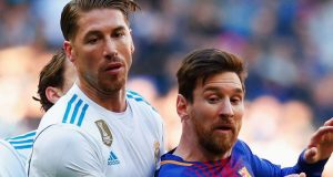 Sergio Ramos of Real Madrid, cagging Lionel Messi of Barcelona