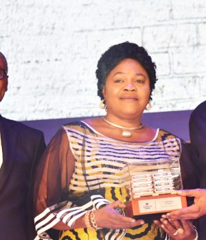 MD Dangote Cement, Olakunle Alake; Best National Distributor of Dangote Cement, Mrs. Beatrice Okika, MD, D. C. Okika Nig. Ltd., receiving an award from President/CE, Dangote Industries Limited, Aliko Dangote
