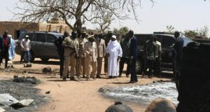 Mali's President Ibrahim Boubacar Keita inspects the damage after an attack by gunmen on Fulani herders in Ogossagou