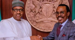 President Buhari receives the National Minimum Wage report from Bismarch Rewane
