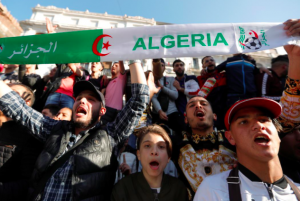 People protest against President Abdelaziz Bouteflika's plan to extend his 20-year rule