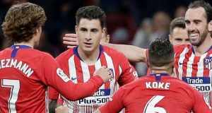 Atletico Madrid players celebrate late winnings against Girona