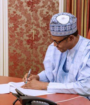 Buhari signs new minimum wage bill to law