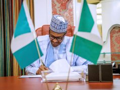 Buhari signs new minimum wage bill to law