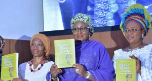 Aisha Buhari with Mrs. Omobolanle Olonisakin, President DEPOWA (right) and Comfort Lamptey, Country Director UN Women, during the book presentation.