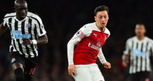 Ozil (centre) has scored five goals in 26 appearances for Arsenal this season