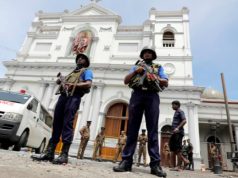 Sri Lanka's security agents stand in front of the church after the attacks