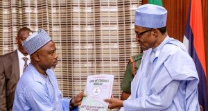 President Buhari receiving Asset declaration form from Chairman CCB Prof. Muhammad Isa