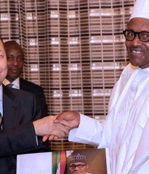 CRCC chairman, Fenjian Chen. with President Buhari