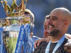 Manchester City coach Pep Guardiola lifts the English Premier League trophy