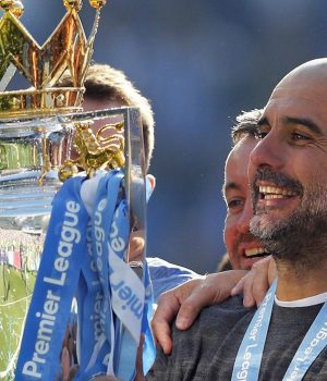 Manchester City coach Pep Guardiola lifts the English Premier League trophy
