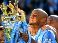 Vincent Kompany lifts the trophy