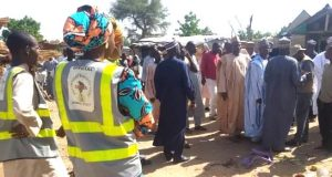 Rescue workers and sympathisers at the Borno suicide attack scene