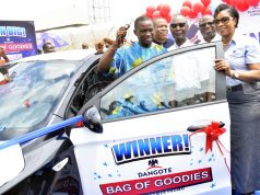 Dangote Cement Bag of Goodies promo winner, Benjamin Igherighe receives his gift