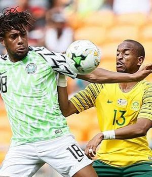 Alex Iwobi confronts a South African player