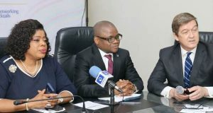 Fidelity Bank officials with PricewaterhouseCoopers official at a media briefing in Lagos