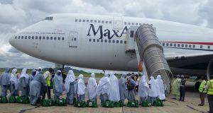Intending pilgrims boarding an MaxAir plane to Saudi