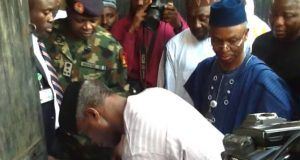 Vice President Yemi Osinbajo signing the condolence register