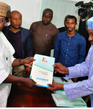 Gov. Yahaya Bello being handed over his nomination form