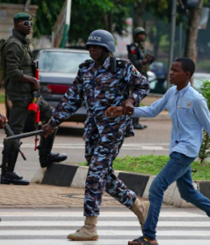 A police officer dragging one of the protesters