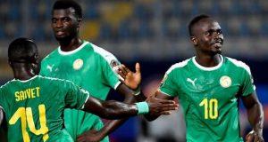 Teranga Lions of Senegal players celebrate after walloping Kenya