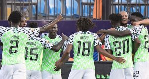 Nigeria's players celebrate their opening goal during the 2019 Africa Cup of Nations (CAN) Round of 16 football match between Nigeria and Cameroon