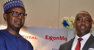 NNPC Chief Financial Officer, Umar Ajiya with Paul McGrath of ExxonMobil