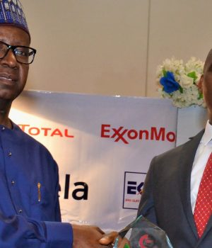 NNPC Chief Financial Officer, Umar Ajiya with Paul McGrath of ExxonMobil