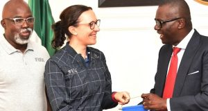 Sanwo-Olu, receives a souvenir from the Head, FIFA Inspection Team, Rhiannon Martin, while NFF President Amaju Pinnick watches