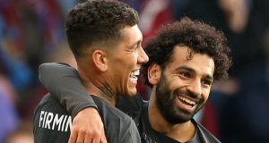 Man City's Filmino and Salah celebrate after crushing Burnley