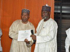 NHIS presenting certificate to NNPC NHIS