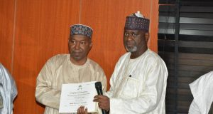 NHIS presenting certificate to NNPC NHIS