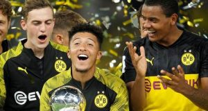 Borussia Dortmund's Jadon Sancho celebrates with the trophy after winning the German Super Cup