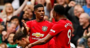 Man United's Marcus Rashford and Antony Martials celebrate victory over Chelsea