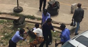 Osun protester being maltreated by police