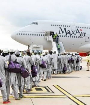Pilgrims boarding Max Air
