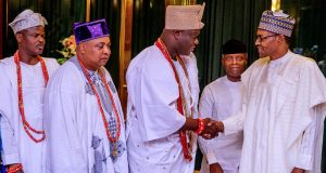 President Buhari shakes hand with Ooni of Ife while others watch