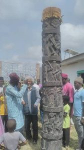 Femi Coker showing Santo Drum to Prof. Wole Soyinka at the Art Gallery in Badagry on Saturday.