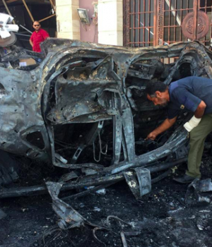 A security official inspects the site where a car bomb exploded in Benghazi, Libya